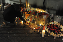 A woman lights candles in front of a memorial place at the Venezuelan Embassy to Chile after the news of Venezuelan President Hugo Chavez s death was released, in Santiago, capital of Chile, on March 5, 2013. Photo by Imago / i-Images...UK ONLY..Contact..Andrew Parsons: 00447545 311662.Stephen Lock: 00447860204379
