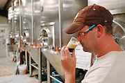 Brian Owens, brewer at O'Fallon Brewery, samples a batch of O'Fallon Smoked Porter for off flavors.