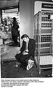 Man slumped asleep in late-night grocery shop  doorway. Shaftesbury Ave, Soho. London.5 December 1997<br />