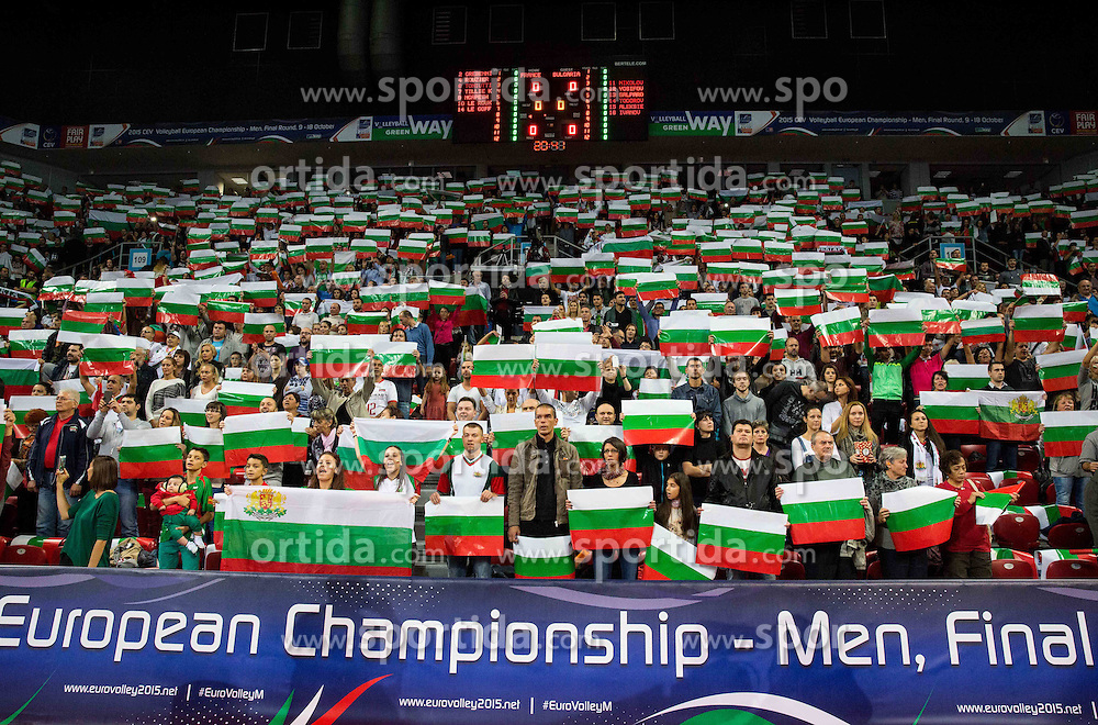 Fans of Bulgaria listening to the national anthem during volleyball match between National teams of France and Bulgaria in 2nd Semifinal of 2015 CEV Volleyball European Championship - Men, on October 17, 2015 in Arena Armeec, Sofia, Bulgaria. Photo by Vid Ponikvar / Sportida