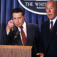 Defense Secretary Caspar Weinberger and Secretary of State George Schultz stand at the podium in the White House press room to discuss details of the April 14, 1986 U.S. bombing of Libya.