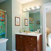 LONG BEACH, NJ - SEPTEMBER 16, 2016: The colorful second floor bathroom linking the pair of guest bedrooms. 6 E. 34 Street, Long Beach, NJ. Credit: Albert Yee for The New York Times