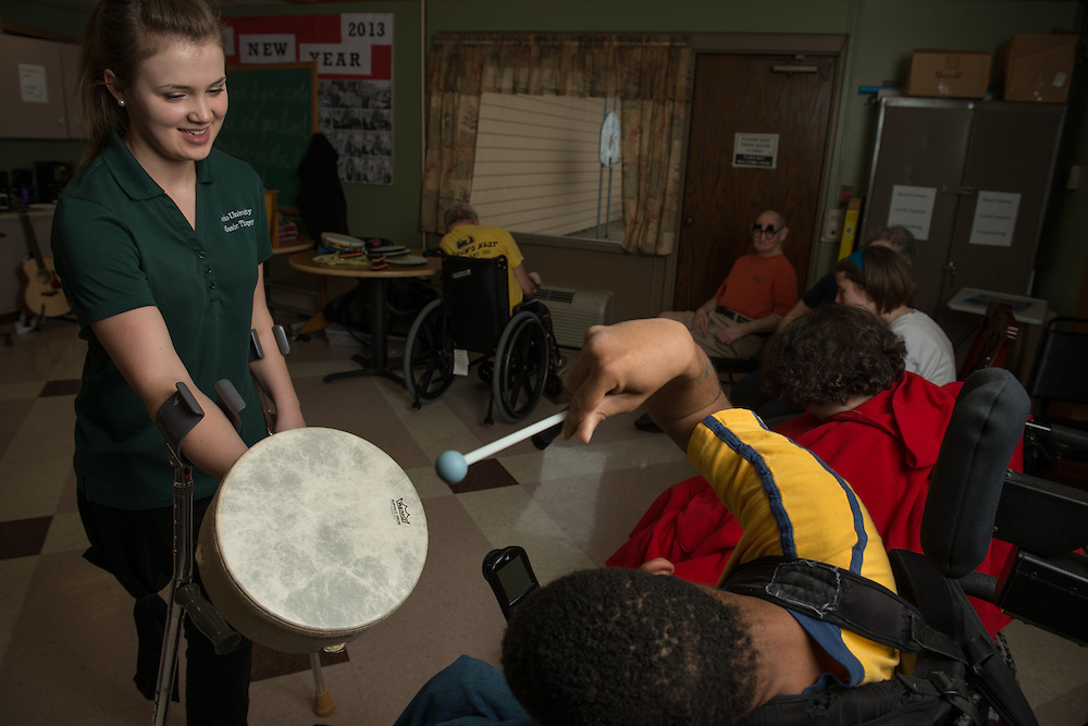 Sara Richardson leads a music therapy program at Echoing Meadows Residential care facility in Athens.