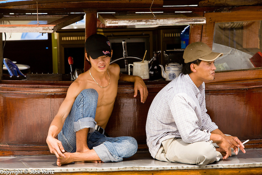 11 MARCH 2006 - MY THO, VIETNAM: A tug boat crew relaxes in the My Tho, the capitol of Tien Giang province, on the Mekong River delta in Vietnam. The Mekong is the lifeblood of southern Vietnam. It is the country's rice bowl and has enabled Vietnam to become the second leading rice exporting country in the world (after Thailand). The Mekong delta also carries commercial and passenger traffic throughout the region.  Photo by Jack Kurtz