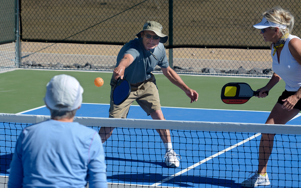 gbs052417b/ASEC -- Sandy Salm, Lou Salm and Jenny Adams, from left, play pickle ball on the new 24 pickle ball court complex at Manzano Mesa Park on Wednesday, May 24, 2017. The courts include six championship tournament courts with energy-efficient LED lighting and spectator seating. Mike Adams, a member of the ABQ Pickleball Club, said the National Senior Games will be played on the courts in 2019.(Greg Sorber/Albuquerque Journal)