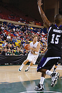 November 25th, 2010:  Anchorage, Alaska - University of Alaska-Anchorage guard Steve White (14) drives in the Seawolves 54-86 loss to Weber State in the first round of the Great Alaska Shootout.