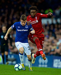 LIVERPOOL, ENGLAND - Sunday, March 3, 2019: Liverpool's Divock Origi (R) challenges Everton's Seamus Coleman during the FA Premier League match between Everton FC and Liverpool FC, the 233rd Merseyside Derby, at Goodison Park. (Pic by Paul Greenwood/Propaganda)