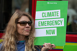 London, UK. 1st May, 2019. A climate protester attends a Declare A Climate Emergency Now demonstration in Parliament Square organised to coincide with a motion in the House of Commons to declare an environment and climate emergency tabled by Leader of the Opposition Jeremy Corbyn. The motion, which does not legally compel the Government to act, was passed without a vote.