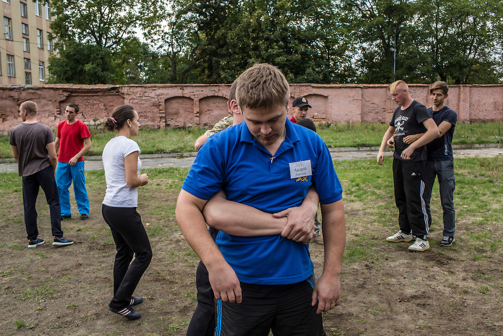 LVIV, UKRAINE - OCTOBER 5, 2015: Recruits take part in tactical training for new patrol police officers, learning techniques to physically subdue a suspect, in Lviv, Ukraine. In an effort to reform the notoriously corrupt Ukrainian police force, an entirely new force has been established in several cities, including Kiev and Lviv, with a primary focus on patrolling the streets. CREDIT: Brendan Hoffman for The New York Times