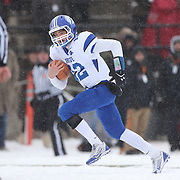 Quarterback Silas Wyper, Darien, rushes for a touchdown  during the New Canaan Rams Vs Darien Blue Wave, CIAC Football Championship Class L Final at Boyle Stadium, Stamford. The New Canaan Rams won the match in snowy conditions 44-12. Stamford,  Connecticut, USA. 14th December 2013. Photo Tim Clayton
