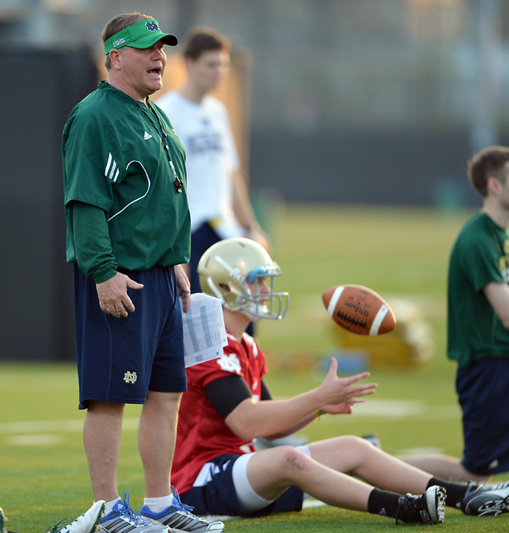 Head coach Brian Kelly, quarterback Gunner Kiel (1) ..