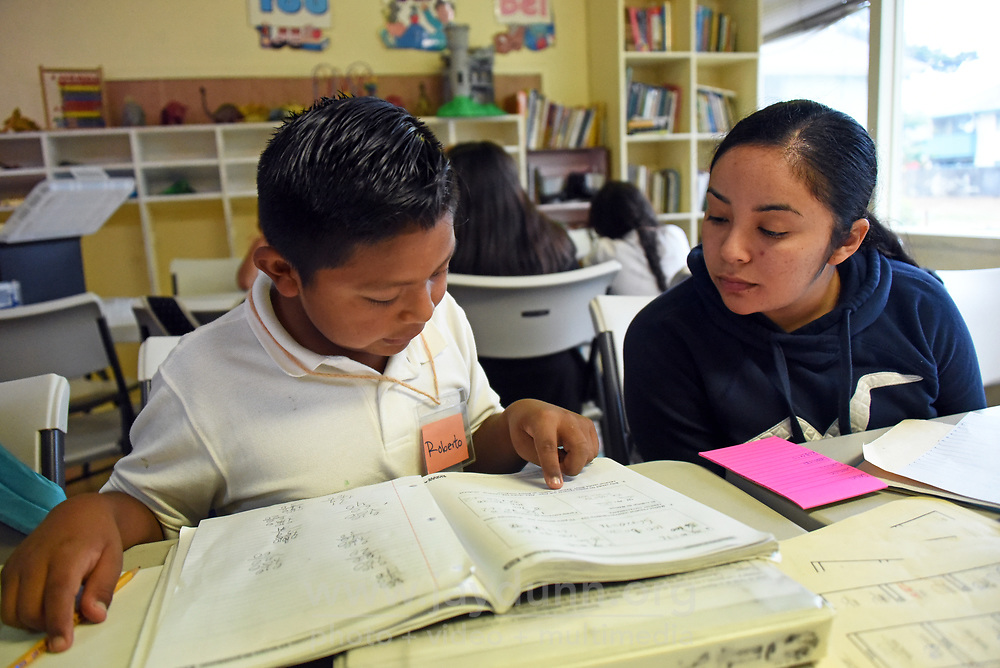 Roberto Tolentino gets some supervision from tutor Eycsel Solorcena at LIFE's after-school program in East Salinas.