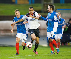Cowdenbeath's Aaron Lynas and Falkirk's Phil Roberts.<br /> half time : Cowdenbeath 0 v 0 Falkirk, Scottish Championship game today at Central Park, the home ground of Cowdenbeath Football Club.<br /> &copy; Michael Schofield.