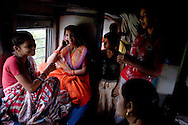 Clockwise from left:.Rani Lakhera, and her sister-in-law Sulochna Lakhera aged 32,.Anjali Lakhera aged 11 (Rani Lakhera's daughter), Kirti Goswamy aged 13 and her elder sister, Nisha Goswamy aged 18.. .Train passengers on the Himsagar Express 6318 going from Jammu Tawi station to Kanyakumari on 8th July 2009.. .6318 / Himsagar Express, India's longest single train journey, spanning 3720 kms, going from the mountains (Hima) to the seas (Sagar), from Jammu and Kashmir state of the Indian Himalayas to Kanyakumari, which is the southern most tip of India...Photo by Suzanne Lee / for The National