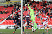 Blackpool goalkeeper Colin Doyle (1) saves during the Sky Bet League 1 match between Doncaster Rovers and Blackpool at the Keepmoat Stadium, Doncaster, England on 28 March 2016. Photo by Simon Davies.