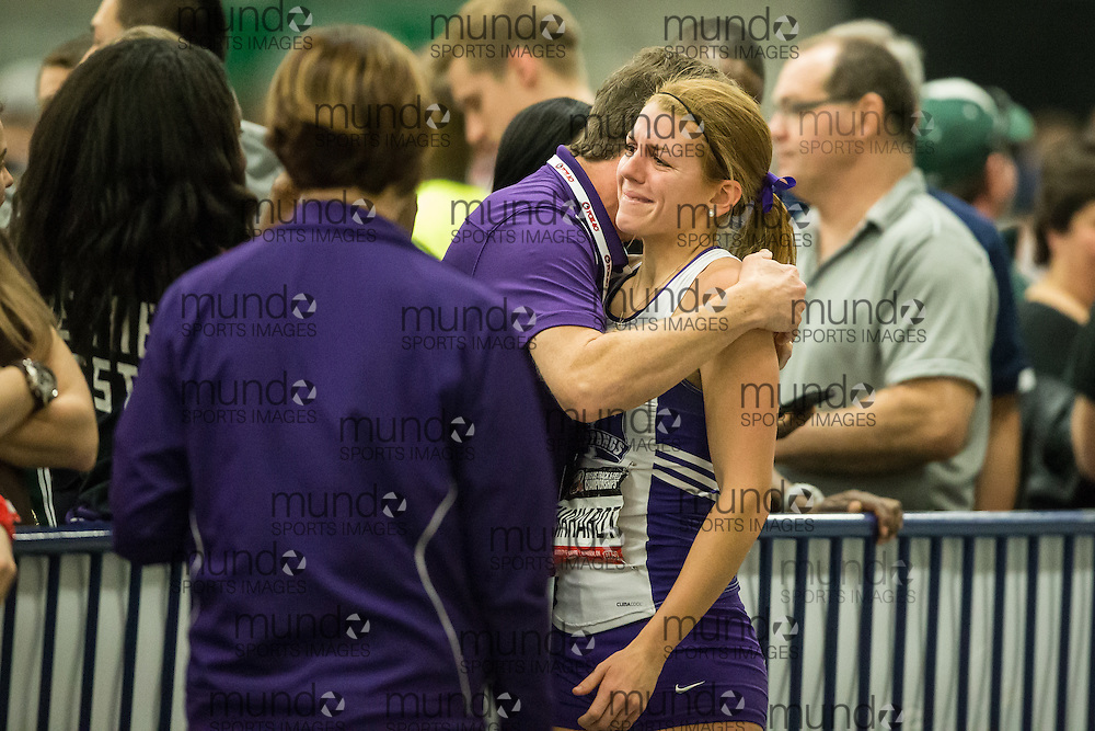 Windsor, Ontario ---2015-03-14---  A teary Caroline Ehrhardt of Western gets a hug from coach Frank Erle after winning the gold medal in the triple jump at the 2015 CIS Track and Field Championships in Windsor, Ontario, March 14, 2015.<br /> GEOFF ROBINS/ Mundo Sport Images
