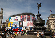 A tour bus with The Original Tour drives past the statue of Eros on its route through Piccadilly Circus Square, on 7th July 2017, in central London.