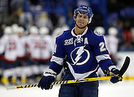 Tampa Bay Lightning's Martin St. Louis reacts at the end of an NHL hockey game as the Washington Capitals celebrate Thursday, Feb. 14, 2013, in Tampa, Fla. The Capitals won 4-3.  (AP Photo/Mike Carlson)
