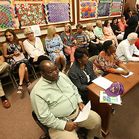 Retirees of the Lee County School District gather with their friends and family at the Lee County School District's central office Tuesday afternoon for a small retirement ceremony where the retirees were recognized for their service.
