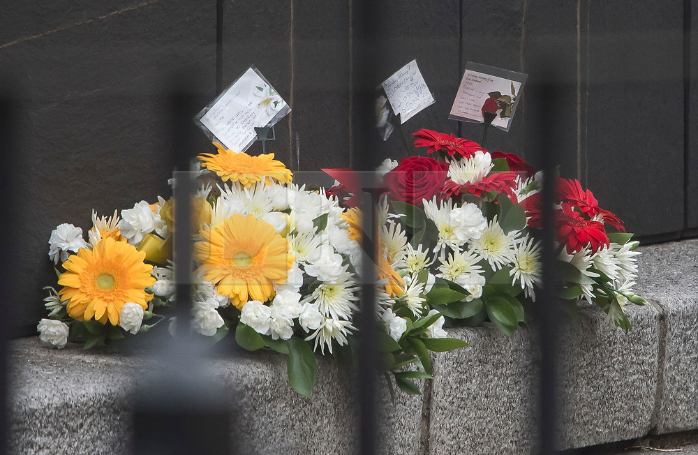 © Licensed to London News Pictures. 22/03/2018. London, UK. Flowers at the scene where PC Keith Palmer died, at New Palace Yard, inside the grounds of the Houses of Parliament in Westminster, London on the one year anniversary of the Westminster Bridge Terror attack. A lone terrorist killed 5 people and injured several more, in an attack using a car and a knife. The attacker, 52-year-old Briton Khalid Masood, managed to gain entry to the grounds of the Houses of Parliament and killed police officer Keith Palmer. Photo credit: Ben Cawthra/LNP