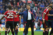 Manchester United Manager Louis van Gaal congratulates Antonio Valencia of Manchester United during the The FA Cup semi final match between Everton and Manchester United at Wembley Stadium, London, England on 23 April 2016. Photo by Phil Duncan.