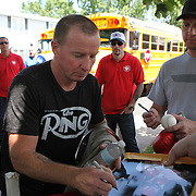 Irish Micky Ward signs autographs during the parade of champions during the 2013 International Boxing Hall of Fame induction ceremony  on Sunday, June 9, 2013 in Canastota, New York.  (AP Photo/Alex Menendez)