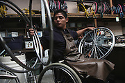 German Chub Choc, Q'eqchi' Mayan from El Estor, works at the Transitions Foundation wheelchair production workshop. On September 27, 2009, German was shot during a botched eviction-turned-melee by Mynor Padilla, former head of security for the Guatemalan Nickel Company (CGN). Since 1996, the Antigua-based organization Transitions has provided youth with disabilities indispensable services involving physical recovery, mental health, education, job training, employment, and above all, social reintegration. Some members suffer from congenital diseases or have been disabled from accidents. But the vast majority has survived a violent attack and now faces the steep challenge of gaining independence and reintegrating in a society indifferent to their special needs. Antigua, Sacatepequez, Guatemala. December 3, 2010.
