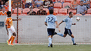 Jun 29, 2016; Houston, TX, USA; Sporting Kansas City midfielder Brad Davis (11) scores a goal against the Houston Dynamo in the second half at BBVA Compass Stadium. Dynamo won 3 to 1. Mandatory Credit: Thomas B. Shea-USA TODAY Sports