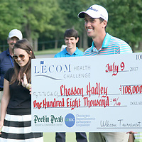 Chesson Hadley holds the large check for winning the LeCom Health Challenge Web.com PGA Tour at Peek n Peak July 9, 2017 photo by Mark L. Anderson