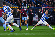 Felipe Anderson of West Ham United (8) gets past the challenge of Alex Pritchard of Huddersfield Town (21) during the Premier League match between Huddersfield Town and West Ham United at the John Smiths Stadium, Huddersfield, England on 10 November 2018.