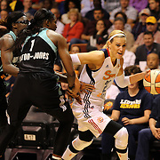 Katie Douglas, (right), Connecticut Sun, in action during the Connecticut Sun Vs New York Liberty WNBA regular season game at Mohegan Sun Arena, Uncasville, Connecticut, USA. 16th May 2014. Photo Tim Clayton