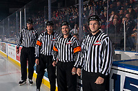 KELOWNA, BC - OCTOBER 12: Linesman Riley Balson, Referees Tyler Adair and Ryan Benbow and linesman Dave McMahon stand outside the timekeepers box at the start of the game at the Kelowna Rockets against the Kamloops Blazers at Prospera Place on October 12, 2019 in Kelowna, Canada. (Photo by Marissa Baecker/Shoot the Breeze)