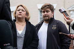 "© Licensed to London News Pictures. 16/11/2019. Bolton, UK. SANDRA RUIZ and TIAGO ALVES of Grenfell United, both of whom are former Grenfell Tower residents , at a press conference at the site of the blaze . Firefighters work at the scene where a fire broke out overnight (15th/16th November 2019) at a block of flats known as "" The Cube "" , in Bolton Town Centre . At least two people are known to have been treated by paramedics at the scene of the six-story block , which is occupied by students of the University of Bolton . Photo credit: Joel Goodman/LNP"
