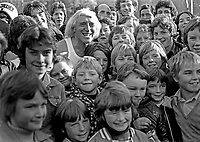 Jimmy Savile with young fans at a Pop for Peace Concert at Crawfordsburn Country Park, Co Down, N Ireland, November 1976. 197611130449a<br />