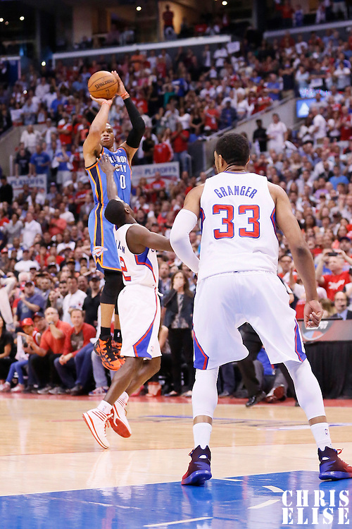 11 May 2014: Oklahoma City Thunder guard Russell Westbrook (0) takes a last jump shot to win the game over Los Angeles Clippers guard Darren Collison (2) during the Los Angeles Clippers 101-99 victory over the Oklahoma City Thunder, during Game Four of the Western Conference Semifinals of the NBA Playoffs, at the Staples Center, Los Angeles, California, USA.