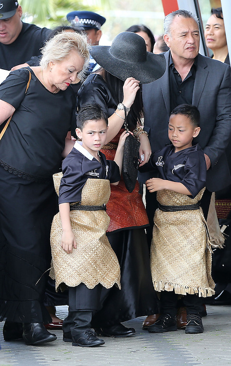 Nadene Lomu, black hat, with sons Brayley and Dhyreille at the `Aho Faka Famili, where  Pasifika communities celebrate the life of Jonah Lomu according to their traditions, Vodafone Events Centre, Manukau, Auckland, New Zealand, Saturday, November 28, 2015.   Credit:SNPA / David Rowland