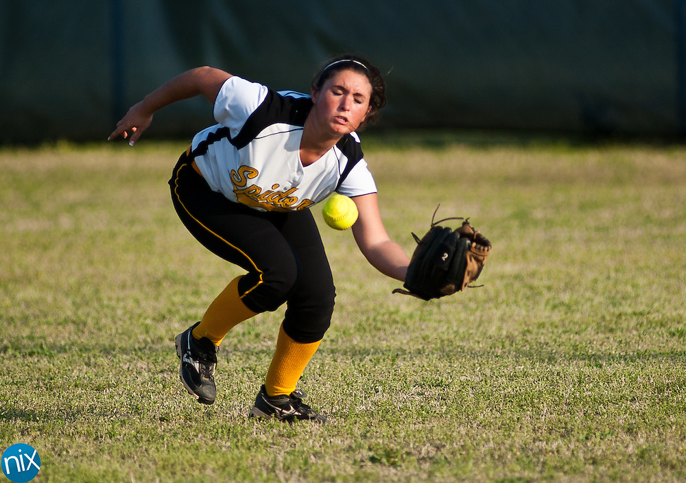 Concord's Jenna Brunhozel bobbles the ball in centerfield during a South Piedmont Conference game against Hickory Ridge Tuesday afternoon in Harrisburg. Hickory Ridge won the game 7-1.  (Photo by James Nix)