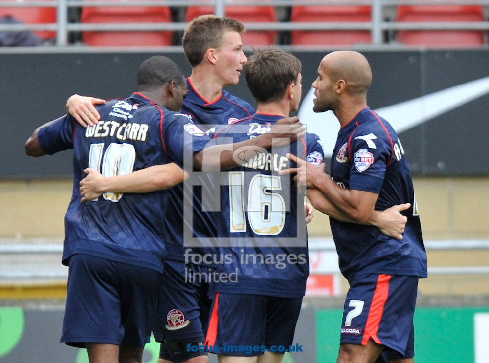 Picture by Alan Stanford/Focus Images Ltd +44 7915 056117<br />28/09/2013<br />Craig Westcarr (L) of Walsall celebrates after scoring the equaliser  with his team mates during the Sky Bet League 1 match at the Matchroom Stadium, London.