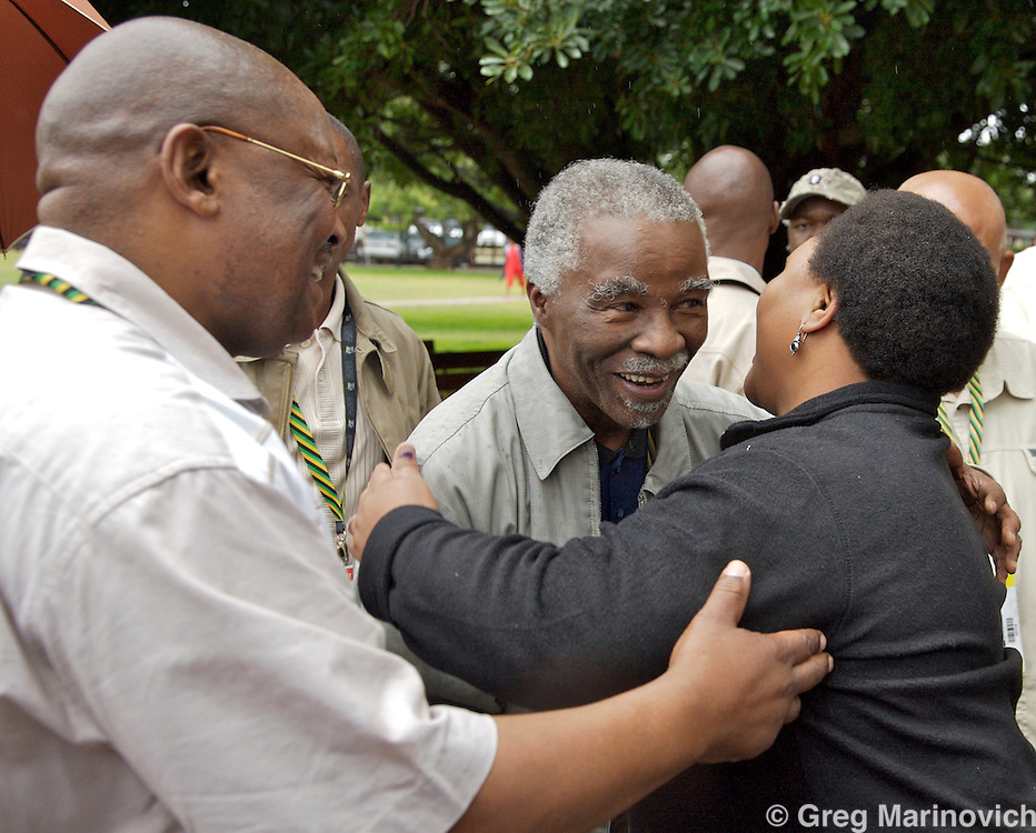 African National Congress President Thabo Mbeki (centre) hugs Public Works Minister Thoko Didiza  to supporters with ANC chairman and Defence Minister Mosiuoa Lekota left, as Mbeki arrives to cast his vote at the African National Congress conference in Polokwane, South Africa, on Monday, Dec. 17, 2007. Photographer: Greg  Marinovich/Bloomberg News
