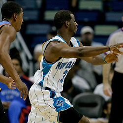 Oct 10, 2009; New Orleans, LA, USA; New Orleans Hornets guard Chris Paul (3) passes the ball as Oklahoma City Thunder guard Kevin Ollie (7) defends from behind during a preseason game at the New Orleans Arena. The Hornets defeated the Thunder 88-79. Mandatory Credit: Derick E. Hingle-US PRESSWIRE