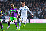 Ezgjan Alioski of Leeds United (10) in action with Jack Hunt of Bristol City (32) at his back during the EFL Sky Bet Championship match between Leeds United and Bristol City at Elland Road, Leeds, England on 24 November 2018.