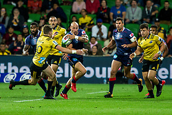 March 30, 2018 - Melbourne, VIC, U.S. - MELBOURNE, AUSTRALIA - MARCH 30 : Billy Meakes of the Melbourne Rebels  deflects a tackle from Beauden Barrett of the Wellington Hurricanes during Round 7 of the Super Rugby Series between the Melbourne Rebels and the Wellington Hurricanes on March 30, 2018, at AAMI Park in Melbourne, Australia. (Photo by Jason Heidrich/Icon Sportswire) (Credit Image: © Jason Heidrich/Icon SMI via ZUMA Press)