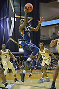 Kent State Golden Flashes guard Jalen Avery (0) shoots against the Vanderbilt Commodores during the second half of an NCAA basketball game in Nashville, Tenn., Friday, Nov. 23, 2018. Kent State won 77-75. (Jim Brown/Image of Sport)