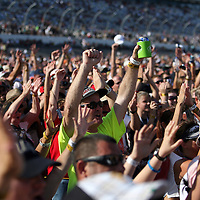 Fans react as the Grammy award winning band Train sings during a one hour performance prior to the start of the NASCAR Coke Zero 400 race at Daytona International Speedway in Daytona Beach, Fl., on Saturday July 7, 2012. (AP Photo/Alex Menendez) Grammy Award winning band TRAIN plays an hour long concert prior to the NASCAR Coke Zero 400 race at Daytona International Speedway in Daytona Beach, Florida on July 7, 2012.