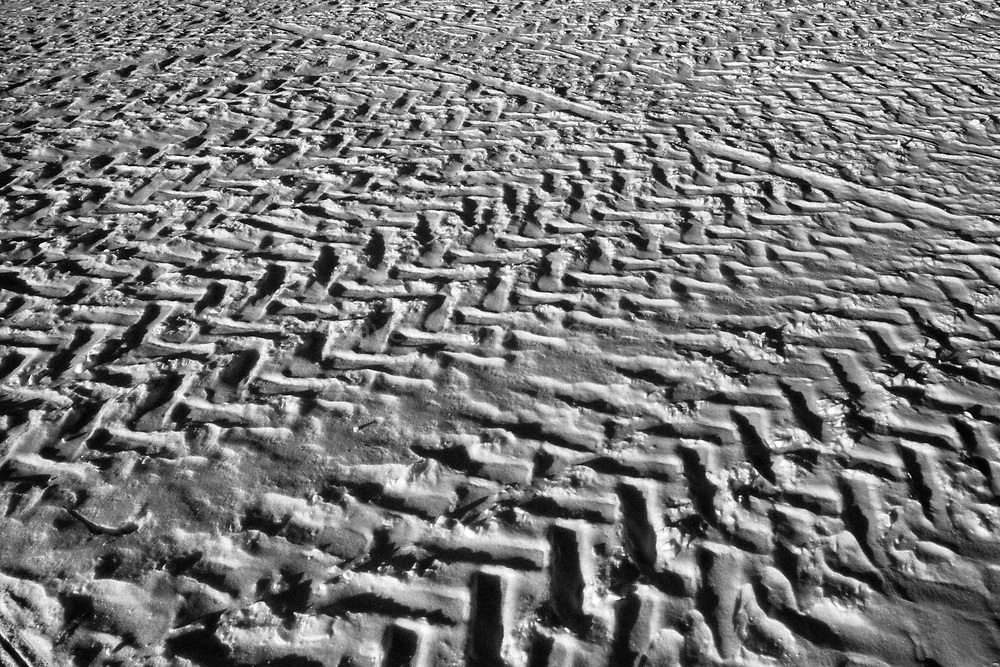 Zig-Zag tyre marks on the snow of frozen Lake Inari, Lapland, Finland, 2005