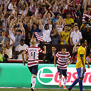 Michael Bradley, USA, (left) and fans celebrate a goal scored by Herculez Gomez during the USA V Brazil International friendly soccer match at FedEx Field, Washington DC, USA. 30th May 2012. Photo Tim Clayton