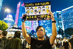 Hong Kong, China. 14th October 2019. Tens of thousands of pro-democracy demonstrators  attended a peaceful rally in Chater Garden in Central on Monday night, calling on the US to pass the Hong Kong Human Rights and Democracy Act of 2019 that would sanction officials who undermine people's rights in the Hong Kong SAR ( Special Administrative region). Many Stars and Stripes flags and pro-USA slogans were displayed by the demonstrators. Iain Masterton/Alamy Live News.