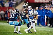 NASHVILLE, TN - DECEMBER 30:  Malcolm Butler #21 of the Tennessee Titans loses his helmet while tackling Jordan Wilkins #20 of the Indianapolis Colts at Nissan Stadium on December 30, 2018 in Nashville, Tennessee.  The Colts defeated the Titans 33-17.   (Photo by Wesley Hitt/Getty Images) *** Local Caption *** Malcolm Butler; Jordan Wilkins