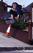 Reaction skateboarder fifty-fifty, five stair rail, U.K, 1990s.