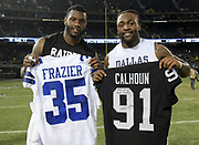 Dec 17, 2017; Oakland, CA, USA; Dallas Cowboys strong safety Kavon Frazier (right) and Oakland Raiders linebacker Shilique Calhoun (left) both exchange their jerseys after their NFL football game at Oakland-Alameda County Coliseum. The Cowboys defeated the Raiders 20-17.
